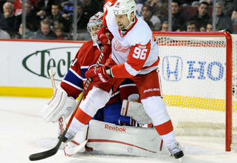 MONTREAL, CANADA - JANUARY 25:  Tomas Holmstrom #96 of the Detroit Red Wings screens Carey Price #31 of the Montreal Canadiens during the NHL game at the Bell Centre on January 25, 2012 in Montreal, Quebec, Canada.  (Photo by Richard Wolowicz/Getty Images
