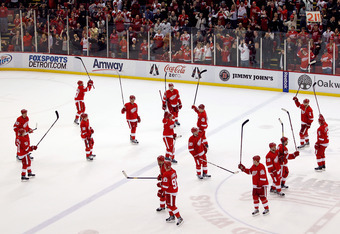 DETROIT, MI - FEBRUARY 14: The Detroit Red Wings salute their fans after their NHL record breaking 21st consecutive home victory by beating the Dallas Stars 3-1 at Joe Louis Arena on February 14, 2012 in Detroit, Michigan. (Photo by Gregory Shamus/Getty I