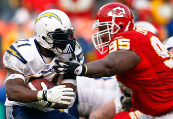 KANSAS CITY, MO - DECEMBER 02:  LaDainian Tomlinson #21 of the San Diego Chargers carries the ball as Ron Edwards #95 of the Kansas City Chiefs defends during the game on December 2, 2007 at Arrowhead Stadium in Kansas City, Missouri.  (Photo by Jamie Squ