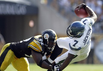 PITTSBURGH, PA - SEPTEMBER 18:   James Harrison #92 of the Pittsburgh Steelers sacks Tarvaris Jackson #7 of the Seattle Seahawks during the game on September 18, 2011 at Heinz Field in Pittsburgh, Pennsylvania.  The Steelers defeated the Seahawks 24-0.  (