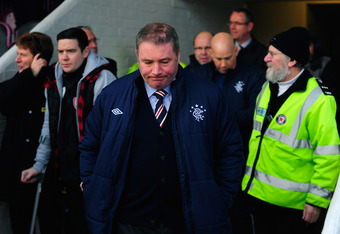 ARBROATH, SCOTLAND - JANUARY 08:  Rangers manager Ally McCoist (c) looks on before the William Hill Scottish Cup Fourth Round match between Arbroath and Rangers at Gayfield park on January 8, 2012 in Arbroath, Scotland.  (Photo by Stu Forster/Getty Images