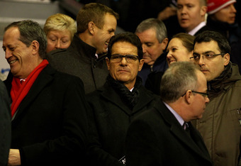 LIVERPOOL, ENGLAND - FEBRUARY 06:  England Manager Fabio Capello looks on with Liverpool Director of Football Damien Comolli (R) prior to the Barclays Premier League match between Liverpool and Tottenham Hotspur at Anfield on February 6, 2012 in Liverpool