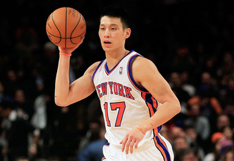 NEW YORK, NY - FEBRUARY 15: Jeremy Lin #17 of the New York Knicks dribbles the ball against the Sacramento Kings at Madison Square Garden on February 15, 2012 in New York City. NOTE TO USER: User expressly acknowledges and agrees that, by downloading and/