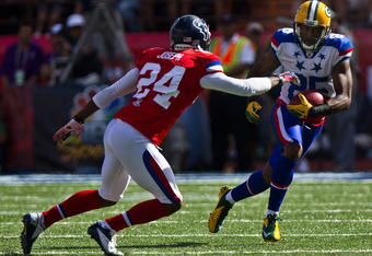HONOLULU, HI - JANUARY 29:  Greg Jennings #25 of the Green Bay Packers carries the ball against Johnathan Joseph #24 of the Houston Texans during the 2012 NFL Pro Bowl at Aloha Stadium on January 29, 2012 in Honolulu, Hawaii.  (Photo by Kent Nishimura/Get