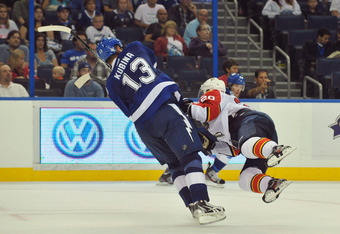 TAMPA, FL - OCTOBER 17:  Defenseman Pavel Kubina #13 of the Tampa Bay Lightning draws a tripping penalty in the third period against Sean Bergenheim #20 of the Florida Panthers October 17, 2011 at St. Pete Times Forum in Tampa, Florida. The Panthers won 7