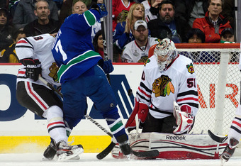 VANCOUVER, CANADA - JANUARY 31: Goalie Corey Crawford #50 of the Chicago Blackhawks makes a save against David Booth #7 of the Vancouver Canucks during the first period in NHL action on January 31, 2012 at Rogers Arena in Vancouver, British Columbia, Cana