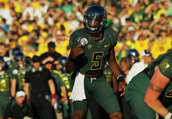 PASADENA, CA - JANUARY 02:  Quarterback Darron Thomas #5 of the Oregon Ducks reacts in the second quarter while taking on the Wisconsin Badgers at the 98th Rose Bowl Game on January 2, 2012 in Pasadena, California.  (Photo by Stephen Dunn/Getty Images)
