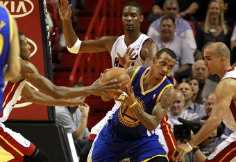 MIAMI - JANUARY 01:  Monta Ellis # 8 of the Golden State Warriors protects the ball  during a game against the Miami Heat at American Airlines Arena on January 1, 2011 in Miami, Florida. The Heat won 114-107. NOTE TO USER: User expressly acknowledges and