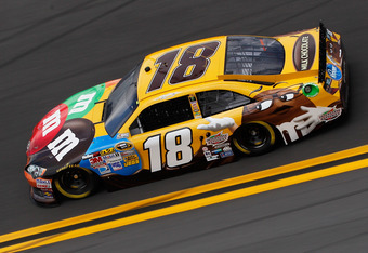 DAYTONA BEACH, FL - FEBRUARY 18:  Kyle Busch, driver of the #18 M&M's Brown Toyota, practices for the NASCAR Sprint Cup Series Daytona 500 at Daytona International Speedway on February 18, 2012 in Daytona Beach, Florida.  (Photo by Chris Graythen/Getty Im