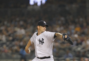 NEW YORK, NY - JULY 29:  A.J. Burnett #34 of the New York Yankees pitches against the Baltimore Orioles on July 29, 2011 at Yankee Stadium in the Bronx borough of New York City.  (Photo by Nick Laham/Getty Images)