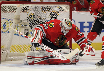 CHICAGO, IL - JANUARY 18: Cory Crawford #50 of the Chicago Blackhawks makes a save against the Buffalo Sabres at the United Center on January 18, 2012 in Chicago, Illinois. (Photo by Jonathan Daniel/Getty Images)