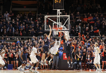CHAMPAIGN, IL - JANUARY 31: Keith Appling #11 of the Michigan State Spartans misses a potential tying shot with four seconds left in the game while being defended by Meyers Leonard #12 and Brandon Paul #3 of the Illinois Fighting Illini at Assembly Hall o