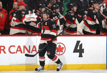 OTTAWA, CANADA - FEBRUARY 11: Daniel Alfredsson #11 of the Ottawa Senators celebrates his first period goal against the Edmonton Oilers during an NHL game at Scotiabank Place on February 11, 2012 in Ottawa, Ontario, Canada.  (Photo by Jana Chytilova/Frees