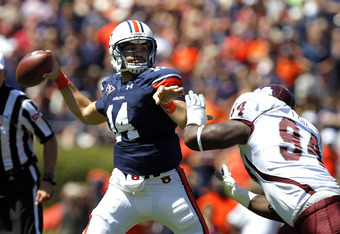 AUBURN, AL - SEPTEMBER 10:  Quarterback Barrett Trotter #14 of the Auburn Tigers throws a pass while under pressure from defensive lineman Fletcher Cox #94 of the Mississippi State Bulldogs in the first quarter on September 10, 2011 at Jordan-Hare Stadium
