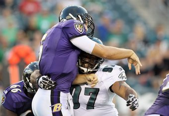 PHILADELPHIA, PA - AUGUST 11:  Cullen Jenkins #97 of the Philadelphia Eagles in action against Joe Flacco #5 of the Baltimore Ravens  during their pre season game on August 11, 2011 at Lincoln Financial Field in Philadelphia, Pennsylvania.  (Photo by Jim