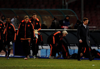 NAPLES, ITALY - FEBRUARY 21:  A dejected Andre Villas-Boas the Chelsea manager and his players walk off the pitch following his team's 3-1 defeat during the UEFA Champions League round of 16 first leg match between SSC Napoli and Chelsea FC at Stadio San
