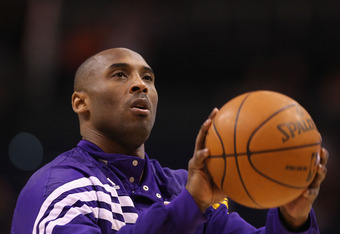 PHOENIX, AZ - FEBRUARY 19:  Kobe Bryant #24 of the Los Angeles Lakers warms up before the NBA game against the Phoenix Suns at US Airways Center on February 19, 2012 in Phoenix, Arizona.  NOTE TO USER: User expressly acknowledges and agrees that, by downl