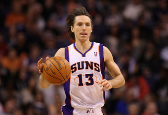 PHOENIX, AZ - FEBRUARY 19:  Steve Nash #13 of the Phoenix Suns moves the ball upcourt during the NBA game against the Los Angeles Lakers at US Airways Center on February 19, 2012 in Phoenix, Arizona. The Suns defeated the Lakers 102-90.  NOTE TO USER: Use