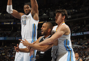 DENVER, CO - MARCH 23:  Tony Parker #9 of the San Antonio Spurs is fouled by Danilo Gallinari #8 of the Denver Nuggets as Nene #31 of the Nuggets helps with defense at the Pepsi Center on March 23, 2011 in Denver, Colorado. NOTE TO USER: User expressly ac