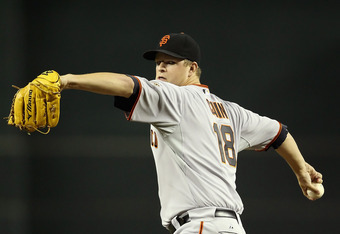 PHOENIX, AZ - SEPTEMBER 23:  Starting pitcher Matt Cain #18 of the San Francisco Giants pitches against the Arizona Diamondbacks during the Major League Baseball game at Chase Field on September 23, 2011 in Phoenix, Arizona. The Diamondbacks defeated the