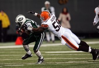 EAST RUTHERFORD, NJ - DECEMBER 09:  Thomas Jones #20 of the New York Jets is tackled by D'Qwell Jackson #58 of the Cleveland Browns on December 9, 2007 at Giants Stadium in East Rutherford, New Jersey.  (Photo by Jim McIsaac/Getty Images)