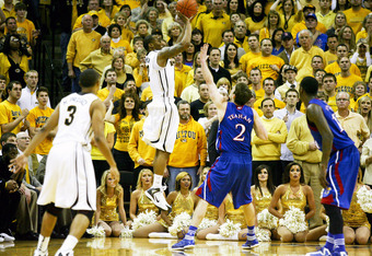 COLUMBIA, MO - FEBRUARY 04:   Marcus Denmon #12 of the Missouri Tigers takes a shot over Conner Teahan #2 of the Kansas Jayhawks during the second  half at Mizzou Arena on February 4, 2012 in Columbia, Missouri. Missouri won 74-71.  (Photo by Ed Zurga/Get