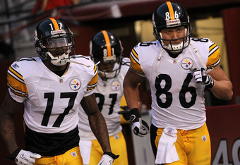 SAN FRANCISCO, CA - DECEMBER 19:  Wide receivers Mike Wallace #17, Arnaz Battle #81 and Hines Ward #86 of the Pittsburgh Steelers run onto the field before the game against the San Francisco 49ers at Candlestick Park on December 19, 2011 in San Francisco,