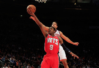 NEW YORK, NY - FEBRUARY 20: MarShon Brooks #9 of the New Jersey Nets shoots in front of Landry Fields #2 of the New York Knicks at Madison Square Garden on February 20, 2012 in New York City. NOTE TO USER: User expressly acknowledges and agrees that, by d