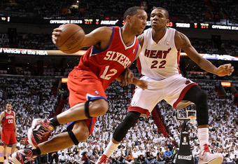 MIAMI, FL - APRIL 27:  Evan Turner #12 of the Philadelphia 76ers drives past James Jones #22 of the Miami Heat during game five of the Eastern Conference Quarterfinals in the 2011 NBA Playoffs at American Airlines Arena on April 27, 2011 in Miami, Florida