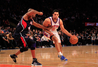 NEW YORK, NY - FEBRUARY 22:  Landry Fields #2 of the New York Knicks drives against Jerry Stackhouse #42 of the Atlanta Hawks at Madison Square Garden on February 22, 2012 in New York City. NOTE TO USER: User expressly acknowledges and agrees that, by dow