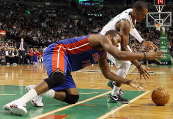 BOSTON, MA - FEBRUARY 15:  Rajon Rondo #9 of the Boston Celtics and Greg Monroe #10 of the Detroit Pistons fight for the loose ball on February 15, 2012 at TD Garden in Boston, Massachusetts. The Detroit Pistons defeated the Boston Celtics 98-88. NOTE TO