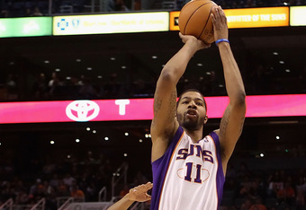 PHOENIX, AZ - FEBRUARY 15:  Markieff Morris #11 of the Phoenix Suns puts up a shot against the Atlanta Hawks during the NBA game at US Airways Center on February 15, 2012 in Phoenix, Arizona. The Hawks defeated the Suns 101-99. NOTE TO USER: User expressl