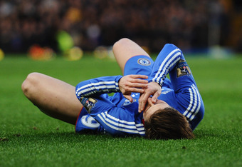 LONDON, ENGLAND - FEBRUARY 06:  Fernando Torres of Chelsea holds his face after a challenge by Daniel Agger of Liverpool during the Barclays Premier League match between Chelsea and Liverpool at Stamford Bridge on February 6, 2011 in London, England.  (Ph