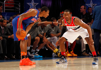 ORLANDO, FL - FEBRUARY 24:  Brandon Knight #7 of the Detroit Pistons and Team Shaq looks to pass the ball John Wall #2 of the Washington Wizards and Team Chuck during the BBVA Rising Stars Challenge part of the 2012 NBA All-Star Weekend at Amway Center on