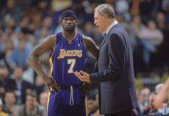 22 Dec 2000:  Isaiah Rider #7 of the Los Angeles Lakers listens to Head Coach Phil Jackson during the game against the Dallas Mavericks at the Reunion Arena in Dallas, Texas. The Lakers defeated the Mavericks 108-103. NOTE TO USER: It is expressly underst
