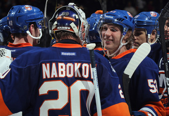 UNIONDALE, NY - FEBRUARY 24: Evgeni Nabokov #20 and Casey Cizikas #53 of the New York Islanders celebrate their 4-3 shootout victory over the New York Rangers at the Nassau Veterans Memorial Coliseum on February 24, 2012 in Uniondale, New York.  (Photo by