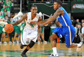 Damier Pitts trying to get around the Memphis defense. The Herd lost Saturday to the Tigers 87-67.