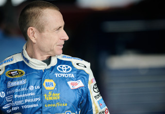 DAYTONA BEACH, FL - FEBRUARY 18:  Mark Martin, driver of the #55 Aaron's Toyota, stands in the garage during practice for the NASCAR Sprint Cup Series Daytona 500 at Daytona International Speedway on February 18, 2012 in Daytona Beach, Florida.  (Photo by