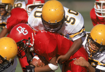 ORLANDO, FL - DECEMBER 9:  Deonte #50 tries to tacckle  #22 John Salazac Jr. both of the Peewee football League  during the Pop Warner Super Bowl at the Disney Wide World Of Sports Complex in Orlando, Florida on December 9th 1998. (Photo by:  Scott Haller