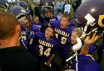 CARLSBAD, CA - NOVEMBER 9:  The Carlsbad Charging Lancers celebrate their 18-0 win over the San Dieguito Ravens during the Pop Warner Division Finals on November 9, 2002 at Carlsbad High School, in Carlsbad, California. The Lancers' have a 10-0 record thi