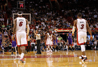 MIAMI, FL - FEBRUARY 21:  LeBron James #6 and Dwyane Wade #3 of the Miami Heat walk up the floor during a game against the Sacramento Kings at American Airlines Arena on February 21, 2012 in Miami, Florida. NOTE TO USER: User expressly acknowledges and ag