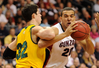 LAS VEGAS, NV - MARCH 06:  Elias Harris #20 of the Gonzaga Bulldogs drives into Angelo Caloiaro #32 of the San Francisco Dons during a semifinal game of the Zappos.com West Coast Conference Basketball tournament at the Orleans Arena March 6, 2011 in Las V