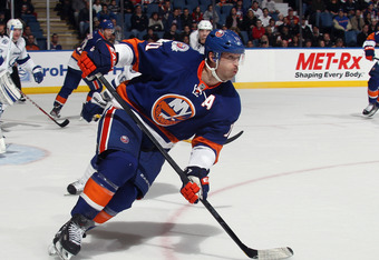 UNIONDALE, NY - DECEMBER 06:  Brian Rolston #11 of the New York Islanders skates against the Tampa Bay Lightning at the Nassau Veterans Memorial Coliseum on December 6, 2011 in Uniondale, New York. The Islanders defeated the Lightning 5-1.  (Photo by Bruc