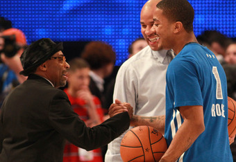 ORLANDO, FL - FEBRUARY 26:  Derrick Rose #1 of the Chicago Bulls and the Eastern Conference greets director Spike Lee (L) during the 2012 NBA All-Star Game at the Amway Center on February 26, 2012 in Orlando, Florida.  NOTE TO USER: User expressly acknowl
