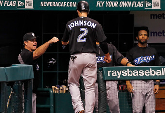 ST. PETERSBURG, FL - SEPTEMBER 25:  Infielder Kelly Johnson #2 of the Toronto Blue Jays is congratulated by manager John Farrell #52 after scoring against the Tampa Bay Rays during the game at Tropicana Field on September 25, 2011 in St. Petersburg, Flori