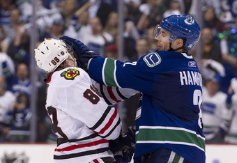 VANCOUVER, CANADA - APRIL 13: Dan Hamhuis #2 of the Vancouver Canucks gives Patrick Kane #88 of the Chicago Blackhawks a push to the face during the third period in Game One of the Western Conference Quarterfinals during the 2011 NHL Stanley Cup Playoffs