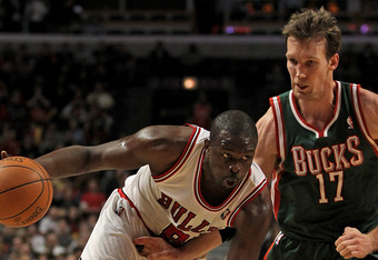 CHICAGO, IL - FEBRUARY 22:  Loul Deng #9 of the Chicago Bulls drives against Mike Dunleavy #17 of the Milwaukee Bucks at the United Center on February 22, 2012 in Chicago, Illinois. The Bulls defeated the Bucks 110-91. NOTE TO USER: User expressly acknowl