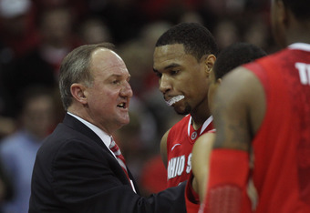 MADISON, WI - FEBRUARY 04:  Head coach Thad Matta of the Ohio State Buckeyes gives instructions to players including Jared Sullinger #0 against the Wisconsin Badgers at Kohl Center on February 4, 2012 in Madison, Wisconsin. Ohio State defeated Wisconsin 5
