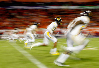 MIAMI GARDENS, FL - JANUARY 04:  The West Virginia Mountaineers kick off to the Clemson Tigers during the Discover Orange Bowl at Sun Life Stadium on January 4, 2012 in Miami Gardens, Florida.  (Photo by Streeter Lecka/Getty Images)