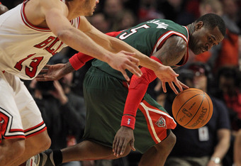 CHICAGO, IL - JANUARY 27: Joakim Noah #13 of the Chicago Bulls knocks the ball away from Stephen Jackson #5 of the Milwaukee Bucks at the United Center on January 27, 2012 in Chicago, Illinois. The Bulls defeated the Bucks 107-100. NOTE TO USER: User expr
